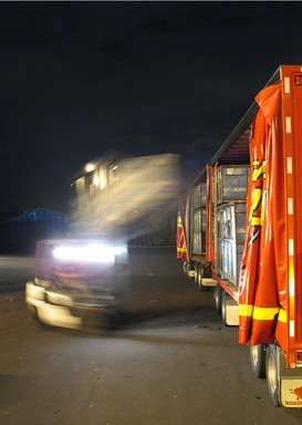 A forklift loads freight into a New Zealand Couriers truck at the company's Auckland depot in Penrose