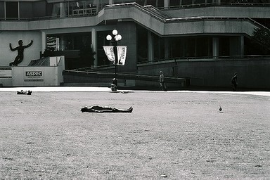 This is part of a series of images I took during a walk through Auckland City at lunch time. This man opted for sun time at lunch time in Aotea Square.