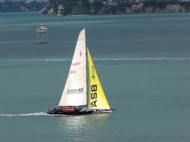 One of the America's Cup yachts in action on the Waitemata Harbour.