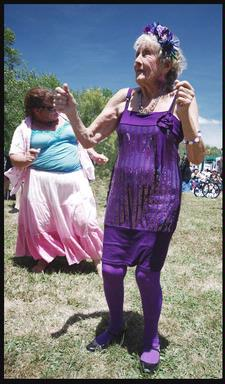 This Elvis fan was given the purple outfit by her family for her 90th birthday. She is dancing at Elvis in the Park in Henderson this month