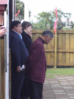 They wait to be welcomed onto the marae