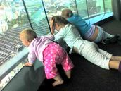 Tavia Khaine; Sisters Flying high; Sharni, 8 mths, on her first skytower visit, with her big sisters watching the jumpers, its just a phone pxt but we love it!
