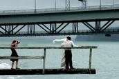 Steven Matthews; Bride,Groom and photographer; Some people will do anything to get the Harbour Bridge into the background.